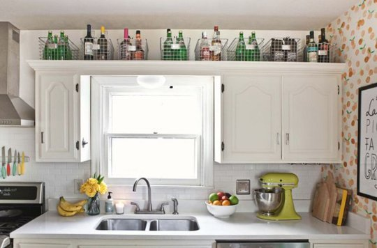 The Space Above Kitchen Cabinets Usually Goes Unused Add Baskets To Hold Utensils Or Bottles Or Stack All Your Cooking Books Or Old Magazines For A More
